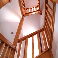 A finished staircase viewed from below